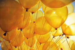 bunch-of-yellow-balloons-lit-by-the-sun