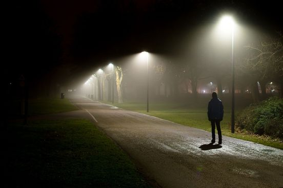 Great words for twilight and darkness merriam webster somber teen walks alone on a dark path m4hsunfo