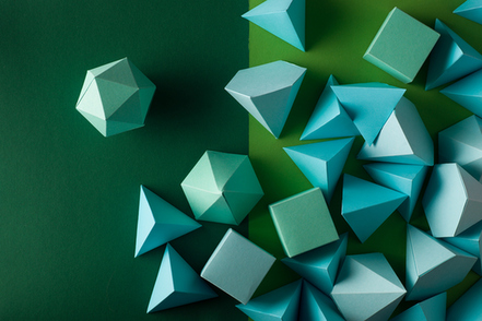 a-pile-of-three-dimensional-shapes-in-green
